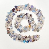 Large @ (arond) sign used for email, made from lots of jigsaw puzzle pieces and separated on a white background.
