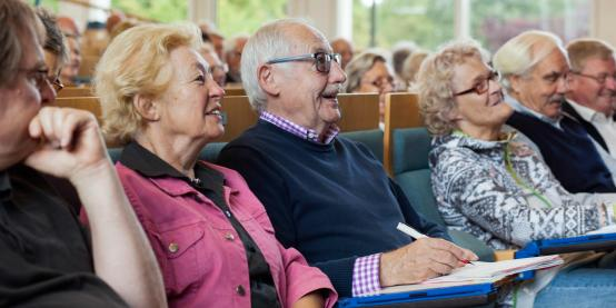 senior citizens entertained by a lecture