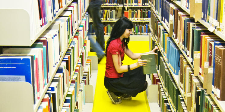 Young woman in the stacks