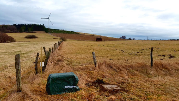 Seismometer in front of Wind Turbine