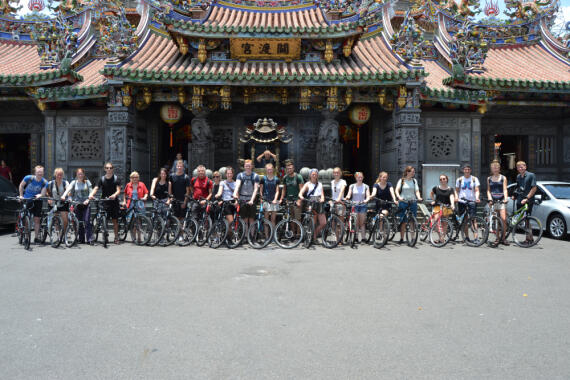 The excursion group with bicycles in front of the Guandu Temple in Taipei
