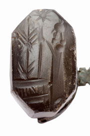 Late Babylonian seal depicting a praying man in front of divine symbols