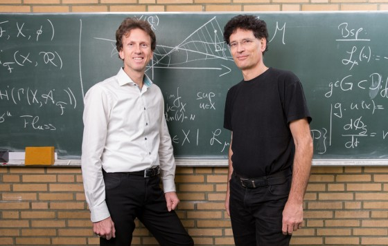 "Prof. Christopher Deninger and Prof. Mario Ohlberger, spokespersons of the Cluster of Excellence ""Mathematics Münster""<address>© WWU - Peter Leßmann</address>"