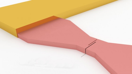High temperature superconducting microbridge (pink) in gold contacts (yellow)<address>© Martin Wolff</address>