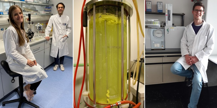 Lydia Steffens and Eugenio Pettinato (University of Münster, left) and Thomas M. Steiner (TUM, right) in the laboratory; the three doctoral students share first authorship of the Nature publication. In the middle, a fermenter system for growing bacteria can be seen.<address>© AG Berg/AG Eisenreich</address>